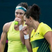 Sam Stosur (L) and Casey Dellacqua in action during the doubles rubber of the Australia v Slovakia Fed Cup tie in Bratislava; Roman Benicky