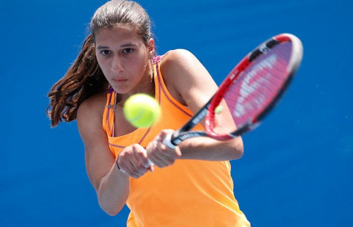 MELBOURNE, AUSTRALIA - JANUARY 26:  Jaimee Fourlis of Australia plays a backhand in her second round match against Chihiro Muramatsu of Japan during the Australian Open 2016 Junior Championships at Melbourne Park on January 26, 2016 in Melbourne, Australia.  (Photo by Darrian Traynor/Getty Images)