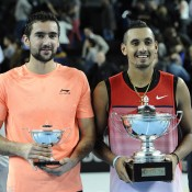 Nick Kyrgios (R) poses with the winner's trophy after beating Marin Cilic (L) to win the ATP Open 13 in Marseille, France; Getty Images