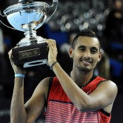 Nick Kyrgios hoists the trophy after winning the ATP Open 13 in Marseille, France; Getty Images