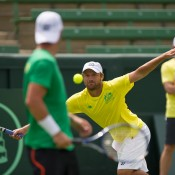 Hitting partner Matt Reid in action as Lleyton Hewitt watches on; Elizabeth Xue Bai