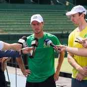 Lleyton Hewitt (centre) and John Peers (R) front the media at Kooyong; Elizabeth Xue Bai