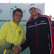 Bernard Tomic (L) and John Isner at the Australia v United States official draw ceremony at Kooyong Lawn Tennis Club