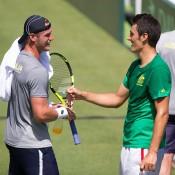 Sam Groth (L) and Bernard Tomic during an Australian team practice session at Kooyong Lawn Tennis Club; Elizabeth Xue Bai