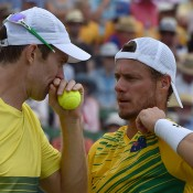 John Peers (L) and Lleyton Hewitt discuss tactics during the doubles rubber of the Australia v United States Davis Cup World Group tie at Kooyong Lawn Tennis Club; Getty Images