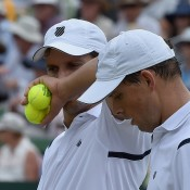 The Bryan brothers discuss tactics during the doubles rubber of the Australia v United States Davis Cup World Group tie at Kooyong Lawn Tennis Club; Getty Images