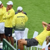Bernard Tomic (R) relaxes courtside during the doubles rubber of the Australia v United States Davis Cup World Group tie at Kooyong Lawn Tennis Club; Getty Images