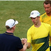US captain Jim Courier (L) shakes hands with John Peers after the doubles rubber of the Australia v United States Davis Cup World Group tie at Kooyong Lawn Tennis Club; Getty Images