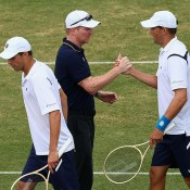 US captain Jim Courier congratulates his team after the Bryan brothers were victorious in the doubles rubber of the Australia v United States Davis Cup World Group tie at Kooyong Lawn Tennis Club; Getty Images