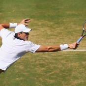 John Isner in action during the reverse singles rubber of the Australia v United States Davis Cup World Group tie at Kooyong; Getty Images