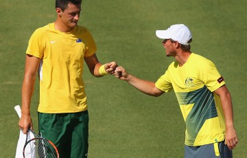 Bernard Tomic (L) and Australian captain Lleyton Hewitt during the reverse singles rubber of the Australia v United States Davis Cup World Group tie at Kooyong; Getty Images