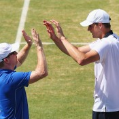 John Isner (R) celebrates with US captain Jim Courier his victory in the reverse singles rubber of the Australia v United States Davis Cup World Group tie at Kooyong; Getty Images