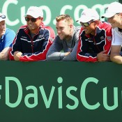 The US Davis Cup team of (L-R) captain Jim Courier, Bob Bryan, Jack Sock, Mike Bryan and John Isner celebrate a 3-1 victory over Australia in the Davis Cup World Group first-round tie at Kooyong; Getty Images