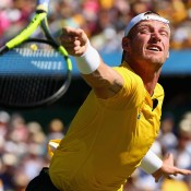 Sam Groth in action against John Isner during the opening singles rubber of the Australia v United States Davis Cup tie at Kooyong Lawn Tennis Club; Getty Images