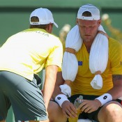 Sam Groth listens to Australian captain Lleyton Hewitt during the opening singles rubber of the Australia v United States Davis Cup tie at Kooyong Lawn Tennis Club; Getty Images