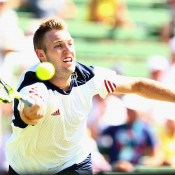 Jack Sock in action against Bernard Tomic during the second singles rubber of the Australia v United States Davis Cup tie at Kooyong Lawn Tennis Club; Getty Images