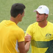 Australian captain Lleyton Hewitt (R) congratulates Bernard Tomic after Tomic beat Jack Sock in the second singles rubber of the Australia v United States Davis Cup tie at Kooyong Lawn Tennis Club; Getty Images