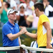 US captain Jim Courier (L) congratulates Bernard Tomic after the Australian beat Jack Sock in the second singles rubber of the Australia v United States Davis Cup tie at Kooyong Lawn Tennis Club; Getty Images