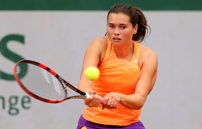 PARIS, FRANCE - JUNE 01:  Isabelle Wallace plays a backhand in her girls's singles match against Varvara Flink of Russia on day eight of the French Open at Roland Garros on June 1, 2014 in Paris, France.  (Photo by Clive Brunskill/Getty Images)