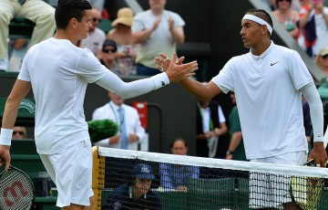 Nick Kyrgios (R) shakes hands with Milos Raonic after winning their third-round match at Wimbledon in 2015; Getty Images