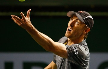 John Millman serves during his second-round defeat to No.30 seed Steve Johnson at the BNP Paribas Open in Indian Wells; Getty Images