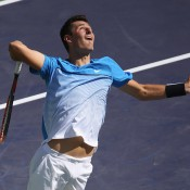 Bernard Tomic in action during his third-round loss to Milos Raonic at Indian Wells; BNP Paribas Open