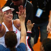 Coco Vandeweghe celebrates the win with her teammates.  Photo: Getty Images
