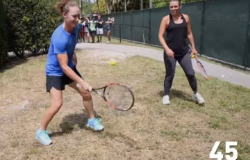 Sam Stosur completes the WTA Frame Challenge as Casey Dellacqua looks on; WTA