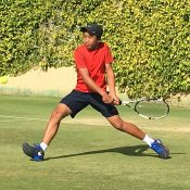 Edward Vo in action at the Australian Grasscourt Championships in Adelaide; Tennis SA
