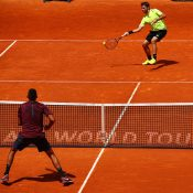 Nick Kyrgios (bottom) in action during his second-round win over Stan Wawrinka (top) at the Mutua Madrid Open; Getty Images