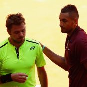 Nick Kyrgios (R) shakes hands with Stan Wawrinka after winning their second-round match at the Mutua Madrid Open; Getty Images