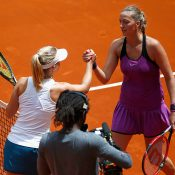 Daria Gavrilova (L) shakes hands with Petra Kvitova after winning their third-round match at the Mutua Madrid Open; Getty Images