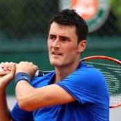 Bernard Tomic plays a backhand during his four-set loss to Borna Coric at Roland Garros; Getty Images