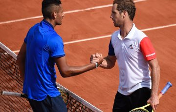 Nick Kyrgios (L) shakes hands with Richard Gasquet after falling to the Frenchman in the third round at Roland Garros; Getty Images