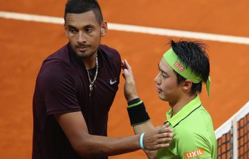 Kei Nishikori (R) shakes hands with Nick Kyrgios after winning their Mutua Madrid Open quarterfinal; Getty Images