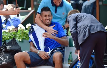 Nick Kyrgios received treatment on his shoulder during his third-round loss to Richard Gasquet at Roland Garros; Getty Images