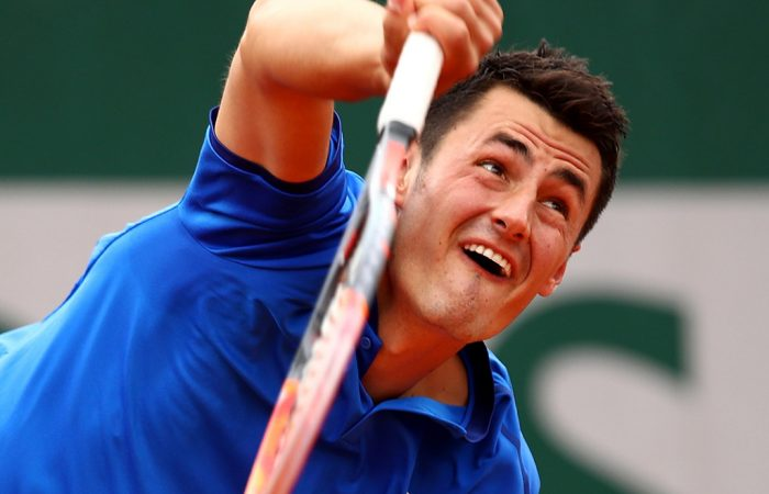 Bernard Tomic serves during his straight-sets win over Brian Baker in the first round at Roland Garros; Getty Images