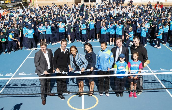 Todd Woodbridge (front row, second from left) was in Canberra to officially open new ANZ Hot Shots mini-courts at two primary schools; Tennis Australia