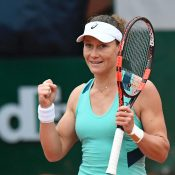 Samantha Stosur reacts after winning her women's quarter-final match against Bulgaria's Tsvetana Pironkova at the Roland Garros 2016 French Tennis Open in Paris on June 1, 2016