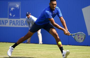 UNDER PRESSURE: Nick Kyrgios stretches for a backhand during his loss to Milos Raonic at Queen's; Getty Images