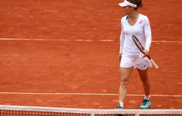 Sam Stosur walks to the net after falling to Garbine Muguruza in the semifinals at Roland Garros; Getty Images
