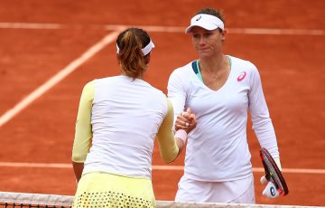 Sam Stosur (R) shakes hands with Garbine Muguruza after falling in their semifinal match at Roland Garros; Getty Images