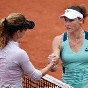 Sam Stosur (R) shakes hands with Tsvetana Pironkova after winning their quarterfinal at Roland Garros; Getty Images