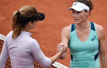 Sam Stosur (R) shakes hands with Tsvetana Pironkova after winning their quarterfinal at Roland Garros; Getty Images