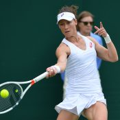 Sam Stosur in action during her first-round win over Magda Linette at Wimbledon; Getty Images