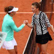 Simona Halep (R) congratulates Sam Stosur after Stosur won their fourth-round match at Roland Garros; Getty Images