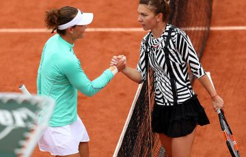 Simona Halep (R) congratulates Sam Stosur after Stosur won their fourth-round match at Roland Garros; Getty Images