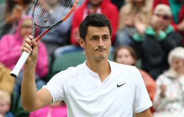 Bernard Tomic waves to the crowd after seeing off Fernando Verdasco in five sets in the first round at Wimbledon; Getty Images