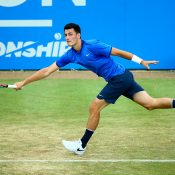 Bernard Tomic reaches for a forehand during his Queen's Club semifinal loss to Milos Raonic; Getty Images