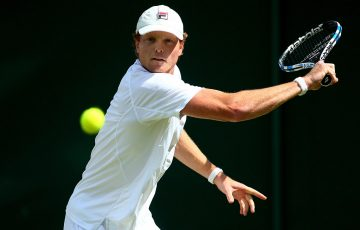 Matt Barton in action during his second-round Wimbledon defeat to 18th seed John Isner; Getty Images